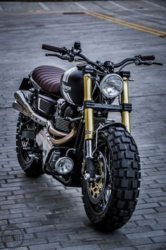 Down & Out Cafe Racers - Triumph Bonneville ScramblerYou can find Triumph motorcycles and more on our website.Down & Out Cafe Racers - Triumph Bonneville Scrambler Triumph Cafe Racer, Triumph Scrambler, Triumph Motorcycles, Indian Motorcycles, Moto Triumph Bonneville, Bonneville Cafe Racer, Cafe Racer Bikes, Cafe Racer Build, Cafe Racers