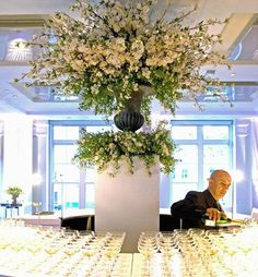 Stunning flower display by @Philippa Craddock in the center of a circular bar at BAFTA, 195 Piccadilly - London