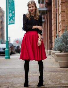 A bright red skirt makes a black outfit pop. | 30 Red Outfits to wear before you're 30.