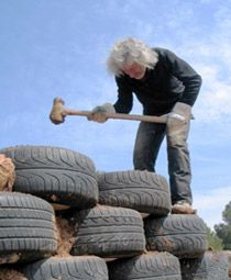 Michael Reynolds, the Garbage Warrior, pounds tires