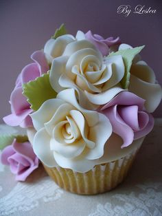a work of art~cupcake with pastel roses