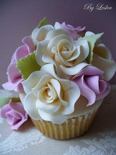 Beautiful lavender and cream roses cupcake.