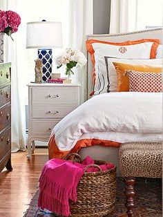Beautiful bedroom with orange and navy accents