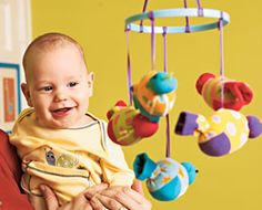 Make a baby mobile from adorable odd infant socks. So cute, so crafty.