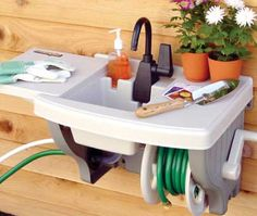 Outdoor sink that requires no plumbing.  It hooks up to your hose!...we need this for cleaning fish!