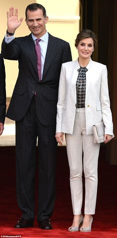 Queen Letizia wore the identical outfit less than two months ago during a visit toPuerto Rico for a language conference where she was then accompanied by husband King Felipe VI (pictured)