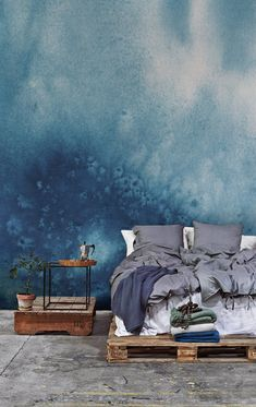 Watercolour for your walls. This sumptuous blue wallpaper design is perfect for bringing calming vibes into your bedroom. Team with rustic wooden furniture for a relaxed yet stylish look.