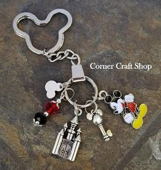 Welcome :) You will receive: 1 pc: Handcrafted KEYCHAIN. High Quality Keychain measures about 4 in length. Comes with: MICKEY HEAD KEY RING CASTLE CHARM ENAMEL MICKEY MOUSE CHARM GLASS BEADS MICKEY MOUSE HEAD CHARM MICKEY kEY CHARM More Disney inspired bracelets, key chains and