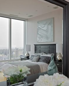 I love the whole room but especially want that art piece above the bed.