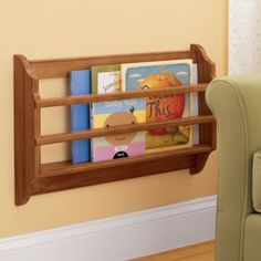 2 or 3 of these book bins from Land of Nod in a corner with a couple of their comfy cozy kid chairs and you have then perfect reading corner