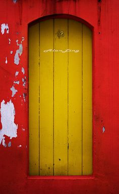 In case the bright yellow of this door isn't enough to catch your eye, the wall surrounding it is an equally dramatic red. The door is actually the back entrance to a shop house down an alley in Singapore.