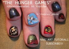 """""""THE HUNGER GAMES NAILS""""  http://www.youtube.com/watch?v=WycpfO0BB2k"""