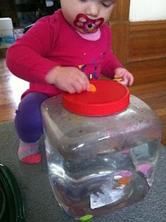 Coins in a Water Jar Instead of practicing putting coins or buttons in a bank, try putting them in a clear container with water in it. It is mesmerizing and pretty to watch them float to the bottom. Motor Activities, Sensory Activities, Preschool Activities, Toddler Play, Early Childhood Education, Fine Motor Skills, Infants, Buttons, Infant Sensory