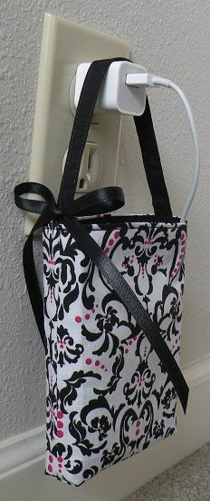 Cell phone wall outlet charge holder by SummitviewOriginals - only $5! ;)..... Would be easy to make.