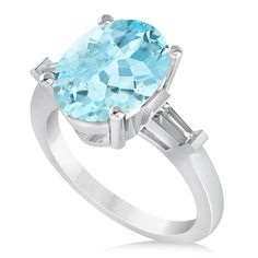 Two baguette-cut rectangular side stones flank a large oval-cut aquamarine to give this white gold engagement ring a unique and beautiful look. Baguette Engagement Ring, Colored Engagement Rings, Best Engagement Rings, Blue Rings, White Gold Rings, Ring Size Guide, Three Stone Rings, Engraved Rings, Aquamarine Rings