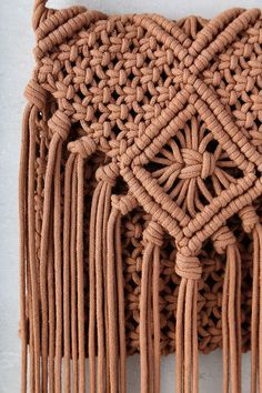 "Perfect your next festival outfit by including the Mahala Terra Cotta Crochet Fringe Purse! This cute crochet bag has 17"" long fringe accents, and interior zipper compartment. Shoulder strap measures 21"" around."