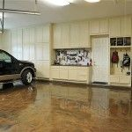 Protect your garage floor from oil stains and update the space's appearance with just a couple of coats of epoxy paint and this easy how-to.