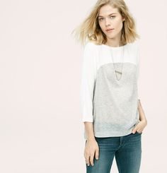 Introducing a new line of easy, texture-rich pieces for your every day. Combining whisper-thin woven details with a soft knit, we love this fluid play on textures. Boatneck. 3/4 dolman sleeves. Side slits. Hi-lo hem.