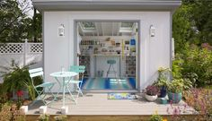 """The Secret to Creating Your Own """"She Shed"""". I like the use of slat wall here. Nicer version of peg board."""