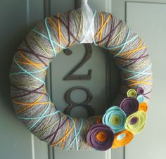 Yarn Wreath Felt Handmade Door Decoration - Inspired 12in. $45.00, via Etsy. Love the Colors