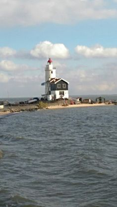 """The Paard van Marken (""""Horse of Marken"""") is a lighthouse on the Dutch peninsula Marken, on the IJsselmeer. It was built in 1839 by J. Valk. A primitive lighthouse had been on the location since the early 1700. The oil lamps of this first lighthouse were designed, made by painter Jan v/d Heyden. The current lighthouse is a Rijksmonument since 1970."""