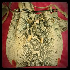 Vince. C* [Snake Skin X-Body Bucket Bag] + Drawstring Mini Bucket Bag + Gold Accent Hardware + Adjustable Strap + Small yet spacious inside + Never Worn + Matches Wedges I'll list soon (bundle?) Vince Camuto Bags Crossbody Bags