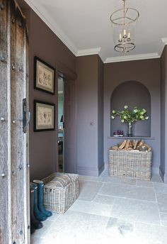 Go for one colour  A single colour used on walls and woodwork creates a strong, unfussy look: this beautiful washed amethyst hue is calm and composed. The all-over shade makes the hallway appear larger than it is, as there are no contrasting skirting boards to break up the planes of colour.