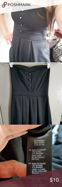 """Forever 21 Little Black Mini Dress Cute short black strapless dress with button accents on bodice, sweetheart neckline and princess seams. Very flattering and can be worn on its own with leggings or over a long -sleeve tee for more coverage. I have only worn it on some Halloweens for my witch costume so it is great condition. Very stretchy material with extra elasticity in the back. The pleated skirt and high waist make it very forgiving. 26"""" around un-stretched at the high waist, and 14""""…"""
