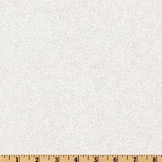 """110"""" Wide Quilt Backing Daisy White from @fabricdotcom  This 110'' wide quilt backing is perfect for quilt backing, duvet covers, curtains and pillow covers. It features a flourish design printed throughout."""