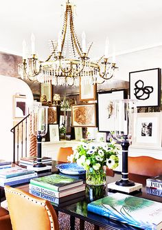 9 reasons why you need leopard print in your home // dining room, crystal chandelier, gallery wall, art, books