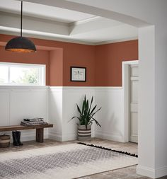 Cavern Clay above the wall trim by Sherwin-Williams