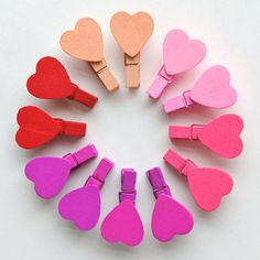 Cute idea - clothespins with wooden hearts on them.