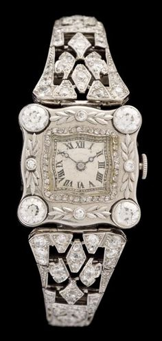 Art Deco platinum and diamond dress watch Square cream face with Roman numeral and dash dial, mechanical movement, petite rose cut diamond bezel, accented by four round cut diamonds approximately 0.25 carats each, total diamond weight for watch approximately 5.25 carats.