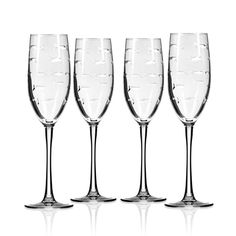 These elegantly presented School of Fish etched flute style cocktail or Champagne goblets are sold in sets of four and are simply perfect with their tiny etched fish for any celebratory occasion!