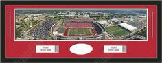One framed large University of Arkansas stadium panoramic with openings for one or two ticket stubs* and one or two 4 x 6 inch personal photos**, double matted in team colors to 39 x 13.5 in.  The lines show the bottom mat color. $189.99            @ ArtandMore.com