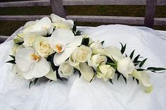 White phalaenopsis orchid stems and crystal blush calla lilies - just like Eva Longoria's.