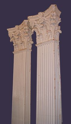 "Amazing pair of painted cast plaster Classical Corinthian fluted pilasters on wooden plinths. 16""W x 8""D capitals; 104 1/2""H ca.1910"