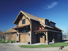 Rustic lodge-style custom horse barn and stalls by Classic Equine Equipment