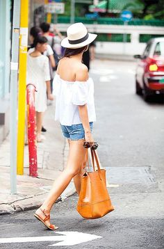 Off the shoulder blouse, jean shorts, fedora, tote and sandals