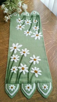 Wool applique & embroidery penny rug. Delightful Daisies Table Runner Pattern CPD-179 by Cath's Pennies Designs - Cathy Wagner .  Check out our wool patterns.  https://www.pinterest.com/quiltwomancom/wool/  Subscribe to our mailing list for updates on new patterns and sales! https://visitor.constantcontact.com/manage/optin?v=001nInsvTYVCuDEFMt6NnF5AZm5OdNtzij2ua4k-qgFIzX6B22GyGeBWSrTG2Of_W0RDlB-QaVpNqTrhbz9y39jbLrD2dlEPkoHf_P3E6E5nBNVQNAEUs-xVA%3D%3D