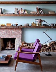 Purple chairs, blue walls, exposed brick, and natural wood