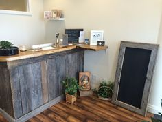 We created this reception desk and chalkboard for a yoga studio.  Made from reclaimed wood and live edge.    www.camstruction.ca Camstruciondesign@gmail.com