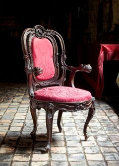 """""""If I could take anything in the gallery, I would take one of the bright red chairs that drip with the essence of royalty. These chairs seem to be straight from the imagery of a dream, in which one becomes a king or queen and is seated in a chair like this. The rich, dark color of the wood flows flawlessly into the red velvety covers of the cushion. I would keep this chair in my room to sit on whenever I wanted to feel important.""""  -- Caswell, 8th Grade"""