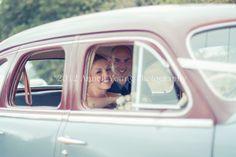 Mariska and Alwyn Singleton in the vintage Pontiac.  Vintage wedding in Patensie, Eastern Cape, South Africa
