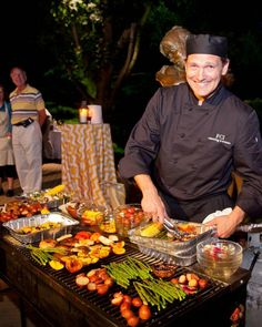 Outdoor grilling makes a fun station for an outdoor reception with a chef from FCI Catering & Events who serves meat, vegetables, and kabobs straight off the grill.
