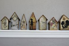 charming village created using book board, book covers and plenty of wonderful embellishments!