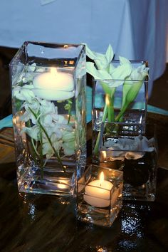 Simple, classic, modern centerpiece white submerged flowers with square glass vases
