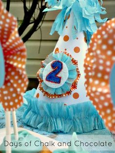 aqua and orange goldfish first birthday party  rosette birthday hat with scrapbook paper