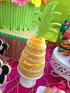 Pineapple cookie towers at a Hawaiian luau Minnie Mouse birthday party! See more party ideas at CatchMyParty.com!