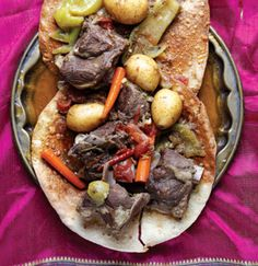 Often referred to as the Prophet Muhammad's favorite dish, this satisfying lamb and vegetable stew is served over thin, cracker-like bread called regag to soak up the rich juices (although we found store-bought, toasted roti to work just as well). See the recipe »